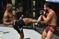 Kamaru Usman kicks Jorge Masvidal in their UFC welterweight championship fight during UFC 251. Photos: Jeff Bottari/Zuffa LLC