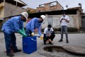 Researchers collect sewage samples to try to detect coronavirus in Belo Horizonte, Brazil. Photo: AFP