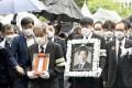 Bereaved family members of Seoul mayor Park Won-soon. Photo: Kyodo