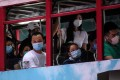 Commuters wear face masks as they travel on the top deck of a tram in Hong Kong on July 10. The emergence of a third wave of Covid-19 infections has led to renewed calls for social distancing and working from home. Photo: AFP