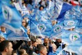 Wigan Athletic fans wave flags before the start of the 2013 English FA Cup final against Manchester City. Photo: AFP
