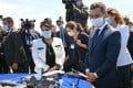 Britain's Home Secretary Priti Patel (C) and French Interior Minister Gerald Darmanin (R) look at French police equipment during their visit in Calais. Photo: AFP