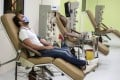A patient who recovered from coronavirus donates his blood plasma in Cairo, Egypt. Photo: EPA-EFE