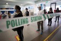 Voters queue to cast their ballots at a polling station in Singapore. Photo: EPA