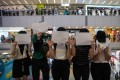 Protesters display sheets of plain white paper during a protest in a shopping mall in Hong Kong. Photo: EPA-EFE