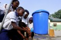 School pupils wash their hands from a bucket in Abuja. Nigeria's population is expected to expand to almost 800 million in 2100, while over 20 countries will see their populations halve by then, a study has predicted. Photo: Reuters