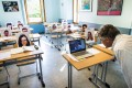 Online tutor Christophe Blanc gives an economics lesson in front of pictures of his students in Switzerland on April 29. Stay-at-home measures to prevent the spread of Covid-19 have increased international demand for remote learning. Photo: EPA-EFE