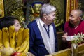 US Ambassador to China Terry Branstad speaks with a monk at the Jokhang Temple in Lhasa in the Tibet Autonomous Region in May 2019. Photo: US Mission to China via AP