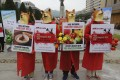 South Korean vegetarian activists wearing dog masks stage a rally opposing the country's culture of eating dog meat. Photo: AP