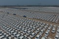 Cars at a logistics base in the Tangshan seaport economic development zone, in China's Hebei province. Photo: Xinhua
