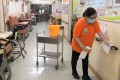 Professional carer Lai Sui-lin, who works at the SAGE Bradbury Home for the Elderly in Aberdeen, is one of many Hong Kong care facility staff feeling the added stress of working amid the Covid-19 pandemic. Photo: Handout