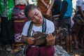 A young woman in Sumba plays a musical instrument, the junga. The Indonesian island is known for its charm and traditional culture, but one tradition, known as catch-a-bride, involving the abduction of young women for forced marriage, has led to a backlash recently. Photo: Shutterstock