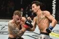 Max Holloway punches Alexander Volkanovski in their featherweight championship fight during UFC 251. Photo: Jeff Bottari/Zuffa LLC via USA TODAY Sports