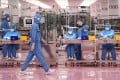 Workers at a cosmetics factory in Otawara, Tochigi prefecture. File photo: AFP
