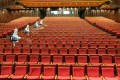 Staff members spray disinfectant at a theatre on May 12 as it prepares to reopen in Yantai, a city in China's eastern Shandong province. Photo: AFP