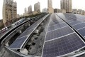 Solar panels at a solar-powered bus station in Shanghai in December 2016. China has more renewable energy capacity than any other country in the world. Photo: Xinhua