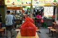 Packed lunch boxes ready for delivery are seen near a food stall in Singapore earlier this year. Photo: AFP