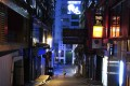 A lone person walks along a deserted street in the usually bustling nightclub area of Lan Kwai Fong in Central on Monday. Photo: Sam Tsang