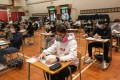 Students wear masks as they take a DSE exam at Lions College, Kwai Chung, on April 25. Photo: Xiaomei Chen
