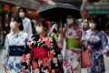 Women in yukata walk along Nakamise Street at Asakusa district, a popular sightseeing spot in Tokyo. Photo: Reuters