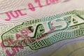 A US visa stamp is seen on a foreign passport. Photo: AFP