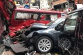 The Tesla crashed into two van parked on Blenheim Avenue in Tsim Sha Tsui. Photo: Jerry Shiu/Facebook