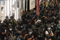 Riot police are seen during a protest marking the one year anniversary of the Yuen Long attack in YOHO Mall, Yuen Long, on Tuesday. Photo: Felix Wong