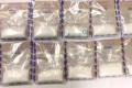 Officers seized about 3kg of suspected ketamine from a hotel room in Sham Shui Po. Photo: Handout