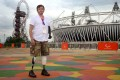 Photographer Giles Duley outside the Olympic Stadium in London. Duley lost three limbs after stepping on an improvised explosive device while covering the Afghanistan war in 2011. Photo: Getty Images