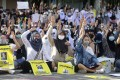 Thai protesters make the three-fingered Hunger Games salute. Photo: AFP