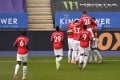 Manchester United players celebrate Bruno Fernandes' penalty that put them in front against Leicester City. Photo: DPA