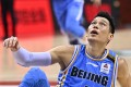 Jeremy Lin of the Beijing Ducks watches play from the floor against the Guangdong Southern Tigers. Photo: Xinhua