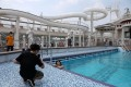 An internet show host poses in the swimming pool on the Explorer Dream cruise ship in Keelung, Taiwan, Cruise sailings have resumed, but with capacity reduced by two-thirds, no buffet service, and the on-board spa and casino closed. Photo: Reuters