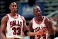 Chicago Bulls star Michael Jordan is restrained by teammate Scottie Pippen in a 1997 NBA game. Pippen has cooled talk of a rift following The Last Dance documentary. Photo: AP