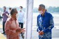 Malaysia Prime Minister Muhyiddin Yassin with Singapore Prime Minister Lee Hsien Loong at a ceremony held on the causeway between the two countries to mark the renewal of an agreement on the Rapid Transit System metro link. Photo: Kenali Johor Jom / Facebook
