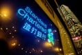 Signage is illuminated at a Standard Chartered branch in Hong Kong. Photo: Bloomberg