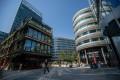 Pedestrians walk around the Hardman Street district of Manchester, UK. Photo: Bloomberg