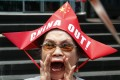 A protester wearing a boat-shaped hat shouts slogans against China's incursions in the South China Sea. While Philippine diplomats work to strengthen relations with Beijing, there is strong anti-China sentiment among Filipinos. Photo: AP