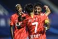 Wei Shihao of Guangzhou Evergrande celebrates with Paulinho after scoring during the second round match between Evergrande and Guangzhou R&F. Photo: Xinhua