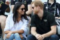 Meghan Markle and Prince Harry pictured during the Invictus Games 2017 in Toronto, Canada. Markle wore a simple white shirt and jeans – and it's a look she still wears today. Photo: AFP