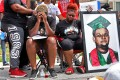 Trinetta Brown (centre left) and Triniya Brown attend a memorial service for their brother, Michael Brown, in Ferguson, Missouri, in August 2018. Photo: St Louis Post-Dispatch via AP