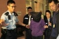 Police officers arrest Kan Kwai-fong. Photo: Handout