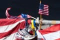 A running shoe and US flag are part of a memorial on the Boston Marathon route in Boston. Photo: AFP