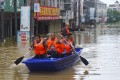 Many Dixi residents had to rely on friends and neighbours with boats to rescue them from their flooded homes. Jiangxi. Photo: Tom Wang