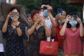 People take photos and video as Chinese authorities prepare to enter the US consulate in Chengdu. Photo: AP