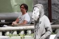 A man uses aplasticbagas a face mask in Kiev, Ukraine. Photo: Reuters