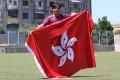 Hong Kong national team player Wai Yuen-ting poses with the Hong Kong flag in Shkoder, Albania. Photo: Graeme Chan