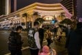 Pedestrians crossing a road outside the Wynn Macau resort. The concessionaire recorded its worst quarterly results in the quarter to June 30, 2020 as the coronavirus chokes the industry. Photo: Bloomberg