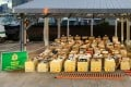 Boxes of good seized in an anti-smuggling operation on Monday are displayed by customs officials. Photo: Handout
