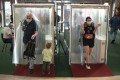 People pass through booths equipped with disinfectant sprays at a shopping centre in Moscow, Russia. Photo: AP